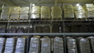 Large furniture warehouse. Mezzanine shelving with large packages of food video
