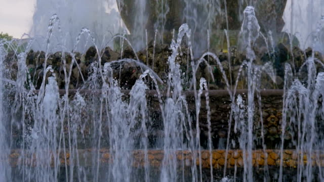 Large jets of water of a beautiful fountain. Slow motion. Shining splash of water. video