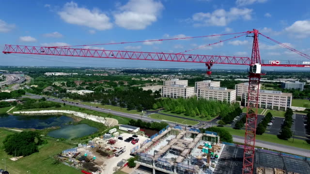 Large Red Construction Crane Heavy Machinery Aerial Drone Side Pan moving across the Arm video