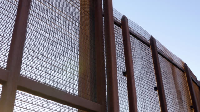 A Large Rusted Metal Wall Separating Two Countries video
