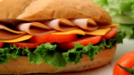 Large sandwich and fresh vegetables video