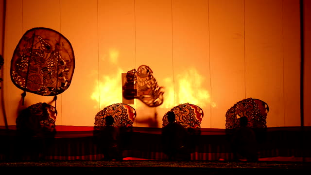 Ratchburi, Thailand - April 13, 2015: Large Shadow Play is performed at Wat Khanon on April 13, 2015. Large Shadow Play or Nang Yai is a performing art which Wat Khanon tries to preserve as a Thai heritage video