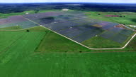 AERIAL: Large Solar Farm in Central Texas Webberville outside of Austin , TX wide angle from far far away entire view aerial drone view video