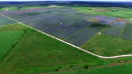 AERIAL: Large Solar Farm in Central Texas Webberville outside of Austin , TX wide angle from far aerial drone view video
