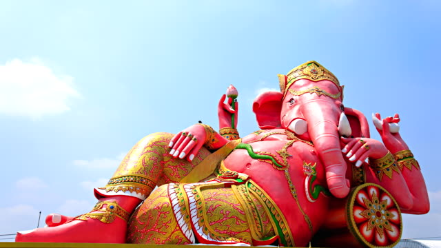 large statue of Ganesh.moving cloud timelapse. video