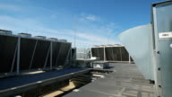 Large ventilation system installed on the roof of an industrial building. Purification of indoor air with the help of external equipment. Beautiful blue sky on the background video