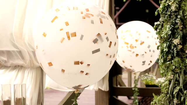 Large white gel balls at the wedding ceremony. video