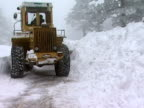 Large Yellow Snow Plow in action video