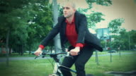 Late 20's businessman riding a bike to work. video