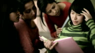 Late teen students consoling to a depressed friend while studying. video