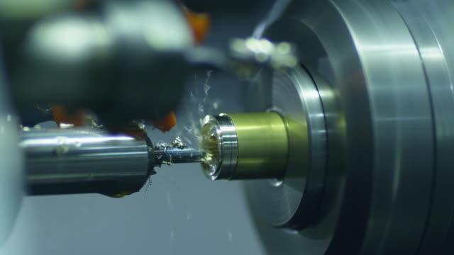 CNC Lathe Machine Produces Metal Detail on Factory. video