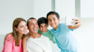 Latin American family taking a selfie video