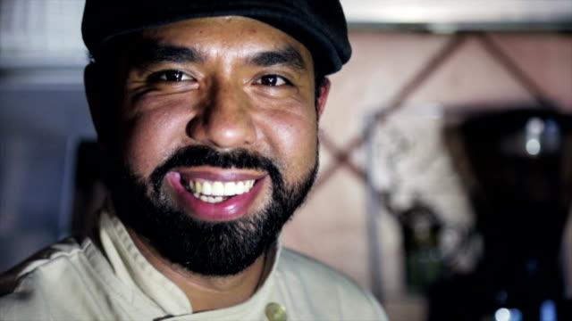 Latin barista smiling video