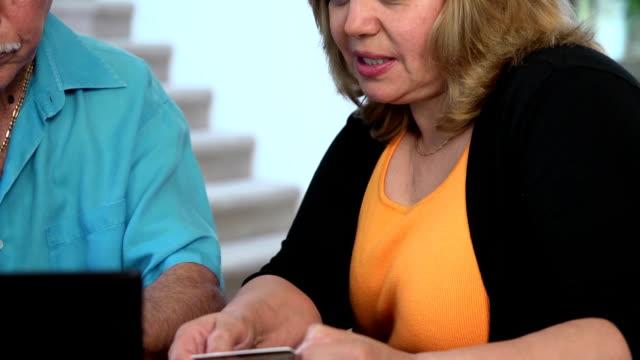 Latin Couple Make Online Purchase - CU Female video