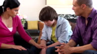 Latin Parents have Serious Discussion with Son - Wide Shot video