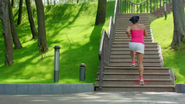 Latin woman run upstairs. Real woman running up stairs. Weight loss exercise video