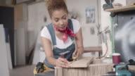 Latina Carpenter Working In Her Workshop video