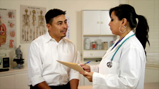 Latina Doctor Shakes Hands with Patient video