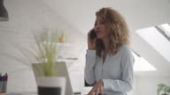 Latina Leadership: Businesswoman working in her office. video