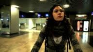 Latina woman on the terminal airport video
