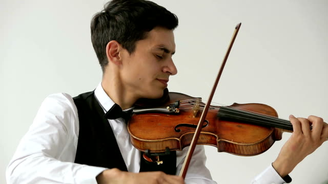 Latino violinist man on a white background. video