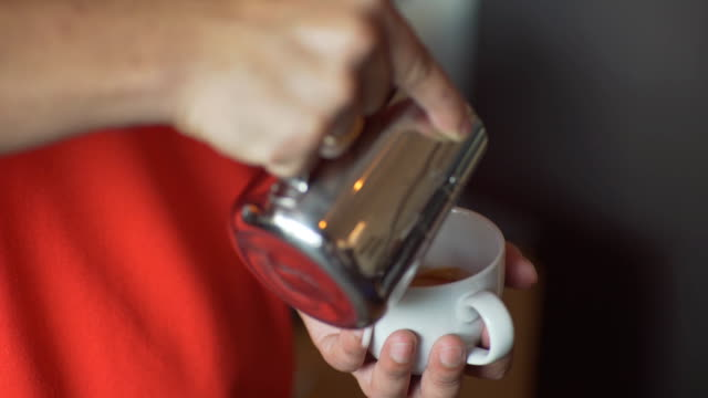 Latte art ,Milk pouring by a Barista video