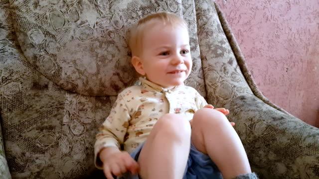 Laughing child have fun watching cartoons video