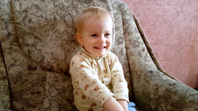 Laughing child watching cartoons video