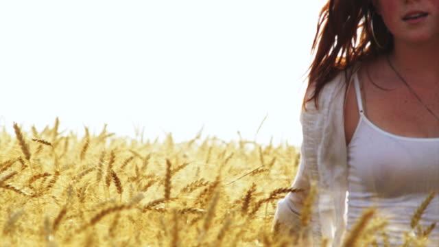 Laughing girl runs through field. video