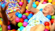 Laughing Girls Playing Plastic Balls video