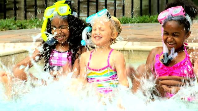 Laughing Little Girls Enjoying Swimming Pool video