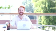 Laughing Man Sitting in Balcony of Office, Outdoor video