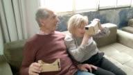 HD: Laughing Senior Couple Using Virtual Reality Simulator video