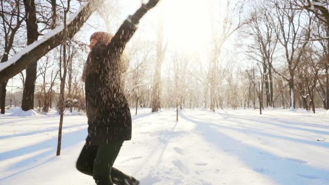 Laughing woman enjoying winter season. video