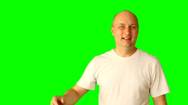 A laughing young man gesticulating on a green screen. Wide smile gestures with hands and head. Clip with premultiplied matted Alpha Channel. Transparent background PNG format. video