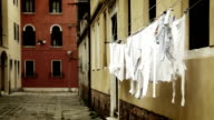 Laundry hangs drying on the narrow street in Venice video