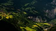 Lauterbrunner and Kleine Sheiddeg villages on mountainsides time lapse video