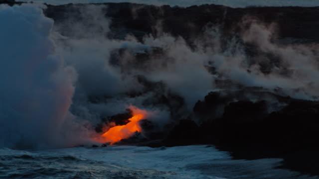Lava flowing into ocean - Kilauea Volcano, Hawaii video