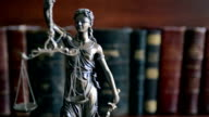 Law concept image with Scales of justice with law books video