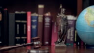 Law concept image with Scales of justice with mallet video