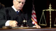 Law Judge using Gavel in Court - Super Slow Motion video