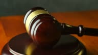 Law justice litigation concept with gavel and hammer video