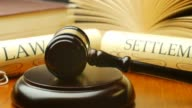 Law settlement justice litigation concept with gavel and hammer video