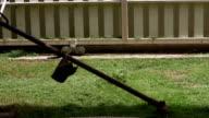 lawnmower man cutting grass in home gardening video