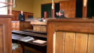 Lawyer questioning Witness with Jury - Two Shots video