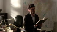 Lawyer working and reading books in the working room. Shot on RED EPIC Cinema Camera. video