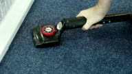 Laying carpet with swooping tools video