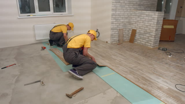Laying floorboard. video