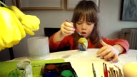 Learning Process-Little girl painting Easter eggs at home video