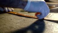 Leather handbag craftsman at work in a workshop video
